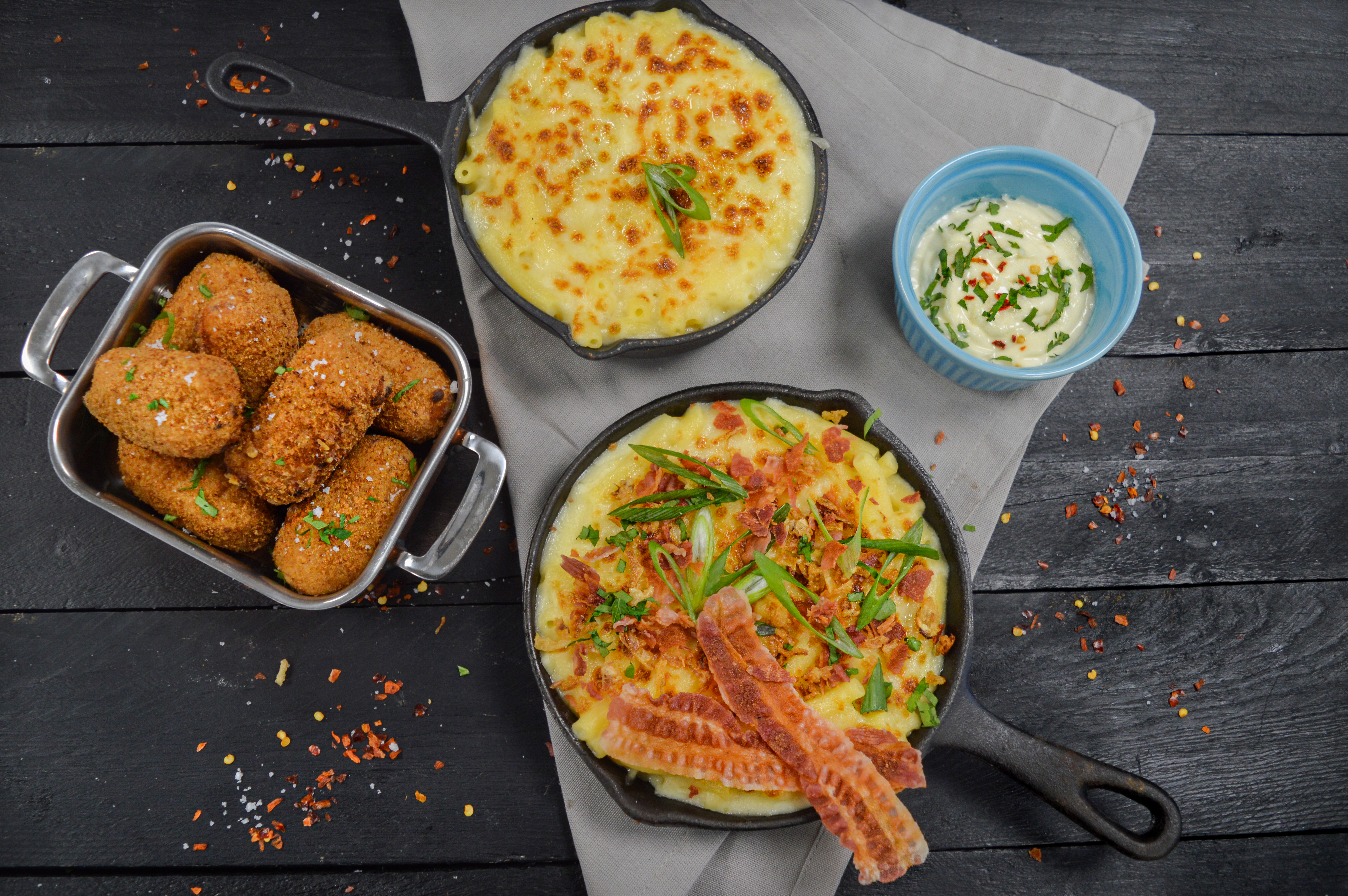 Mac 'n' Cheese Bake fully loaded with bacon and chorizo with Chipotle Mac 'n' Cheese Croquettes